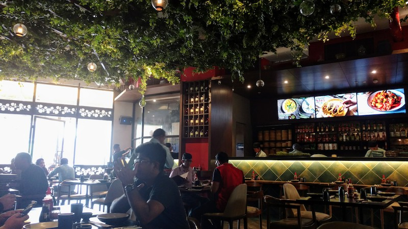 The green canopy inside the restaurant