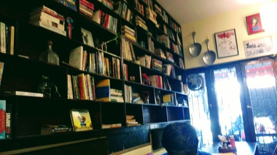 Seat by the window or seat by the book-shelf?