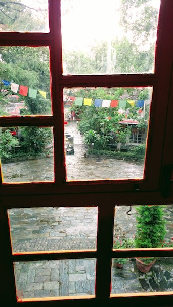 Prayer flags outside the temple situated in the Norbulingka complex