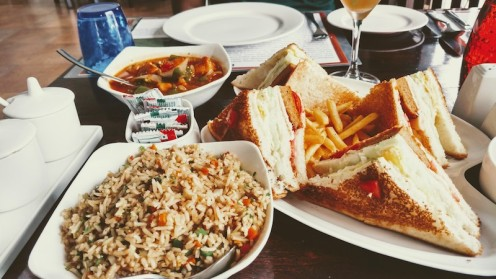 Veg fried rice, chilli chicken and club sandwich