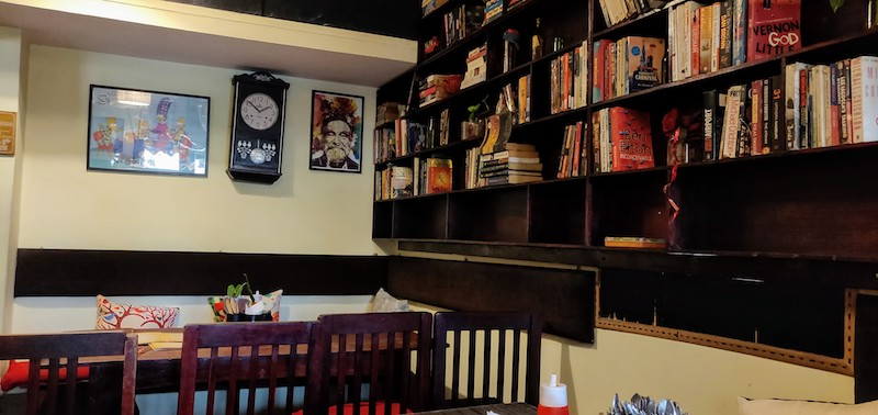Table by the bookshelf @Hole in the Wall Cafe