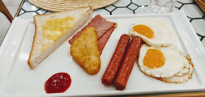 Sausage abd Bacon, Double Sunny Egg, Potato Cake and Butter Toast
