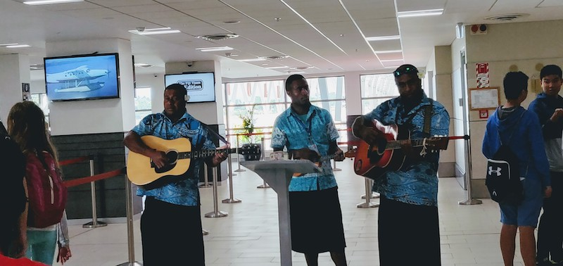 The band at the airport dressed in the traditional sulu