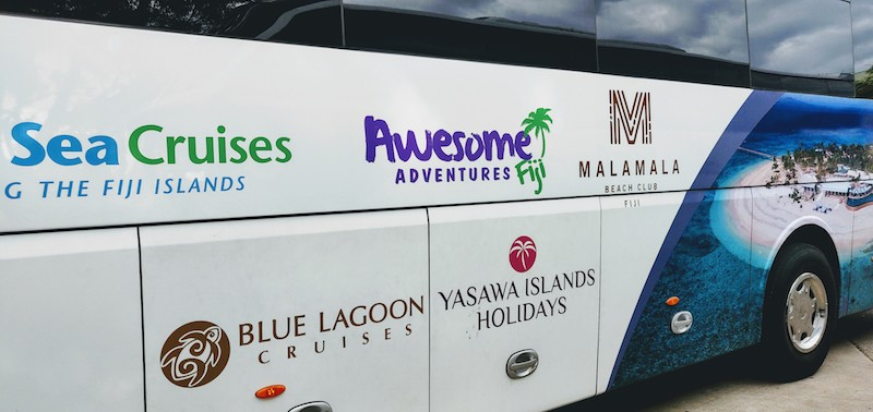 The bus has all the names of the cruises