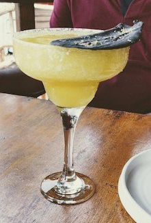 Mango coconut margarita, served with a cardamom chocolate shard