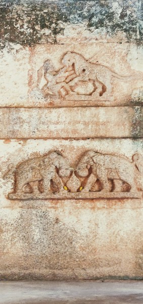 Sculptures of tiger fights and elephant fights adorn the doorway.