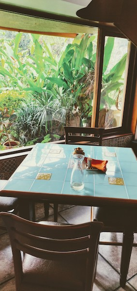 The turquoise tiled table and orange napkins at Mum's kitchen, Panjim