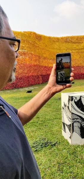 Dr Subodh Kerkar demonstrating the Gandhi AR app at MOG