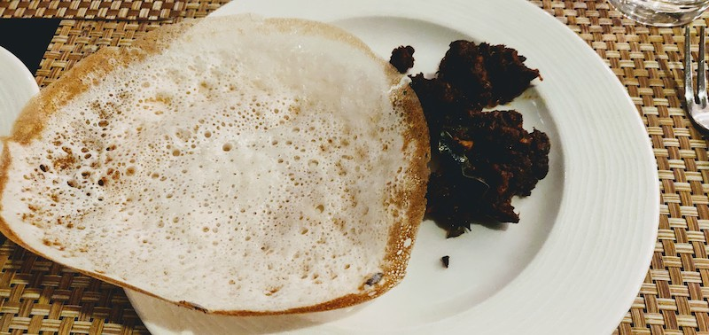 Appam or lace hoppers and beef at the Backwater Cafe, Taj Bekal