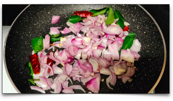 Onion, dry red chillies, onion (or shallots), and curry leaves for the lady's finger stir fry