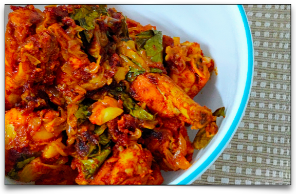 Easy chicken roast with sliced onion, curry leaves and the marinated chicken