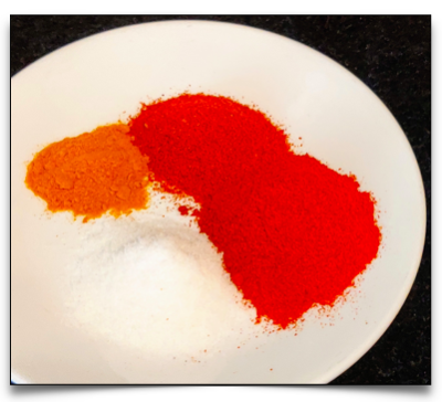 Marinade for the chicken consists of salt, turmeric, normal red chilli powder and kashmiri chilli powder