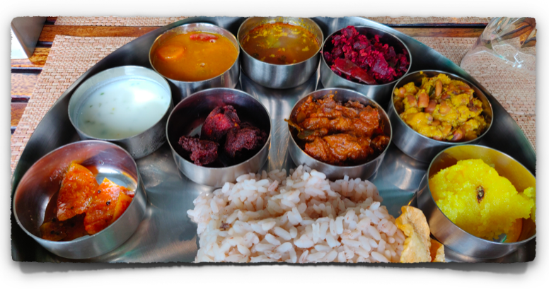 A close up of the curries in the Beef Thali