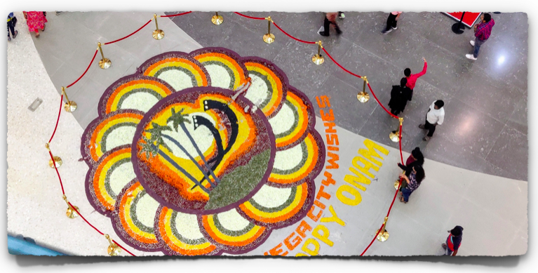 A giant Pookalam (flower carpet) at Vega City Mall, Bangalore, on the occasion of Onam