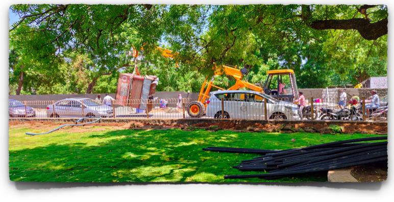 A crane clearing away makeshift shelter of some sortin Mahabalipuram