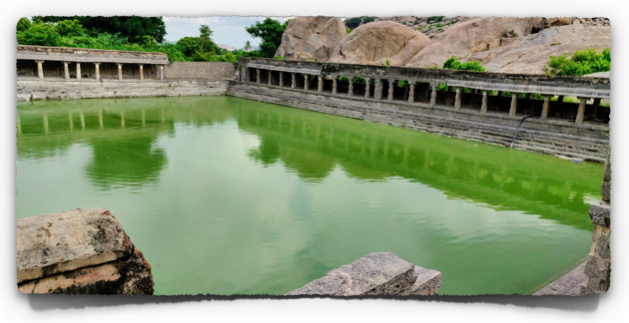 Elephant tank - A large stepped well filled with water at the Gingee fort
