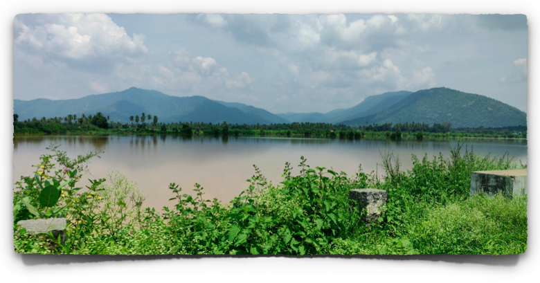 A lake with the Eastern Ghats in the background