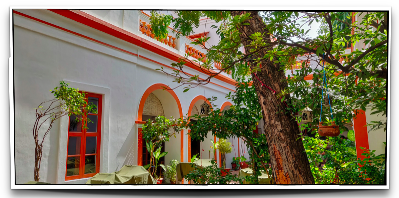 The open courtyard and the colonnaded portico at  Hotel Dune de L'Orient on Rue Romain Rolland, Pondicherry