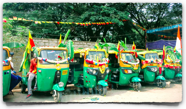Festive decor for the auto rickshaws in Bangalore - the yellow and red flag is the unofficial state flag