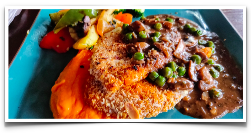 Almond Crusted Chicken with carrot mash, mushroom and peas at Toit, Indiranagar