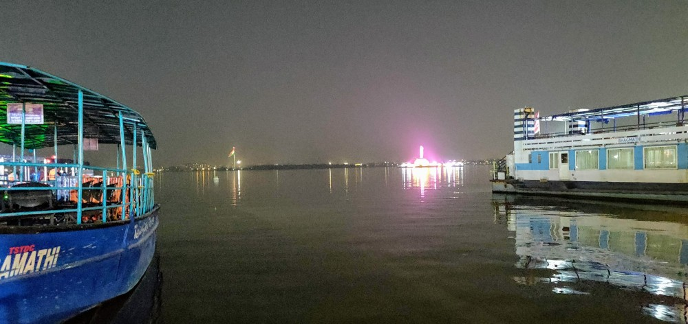 At a distance, the illuminated Buddha statue in the middle of the Hussain Sagar lake, Hyderabad
