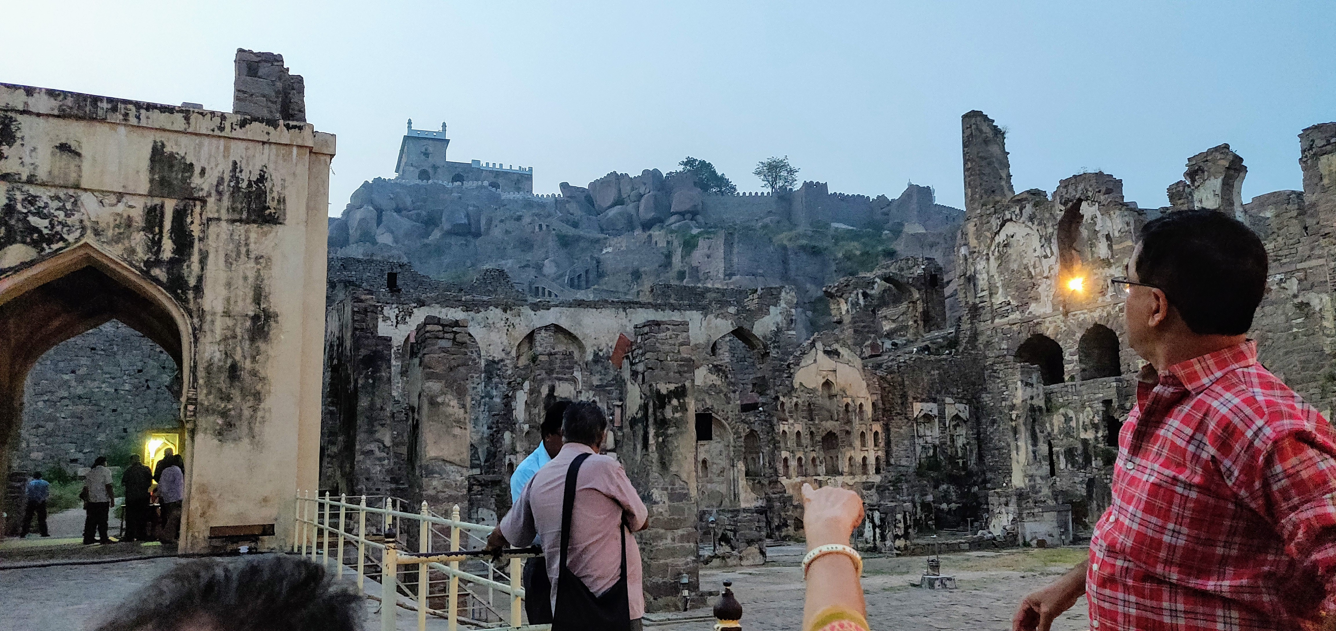 """Rani Mahal - the venue for the sound and light show; the lady pointing to  the """"Bala Hissar"""" - the topmost point of the fort"""