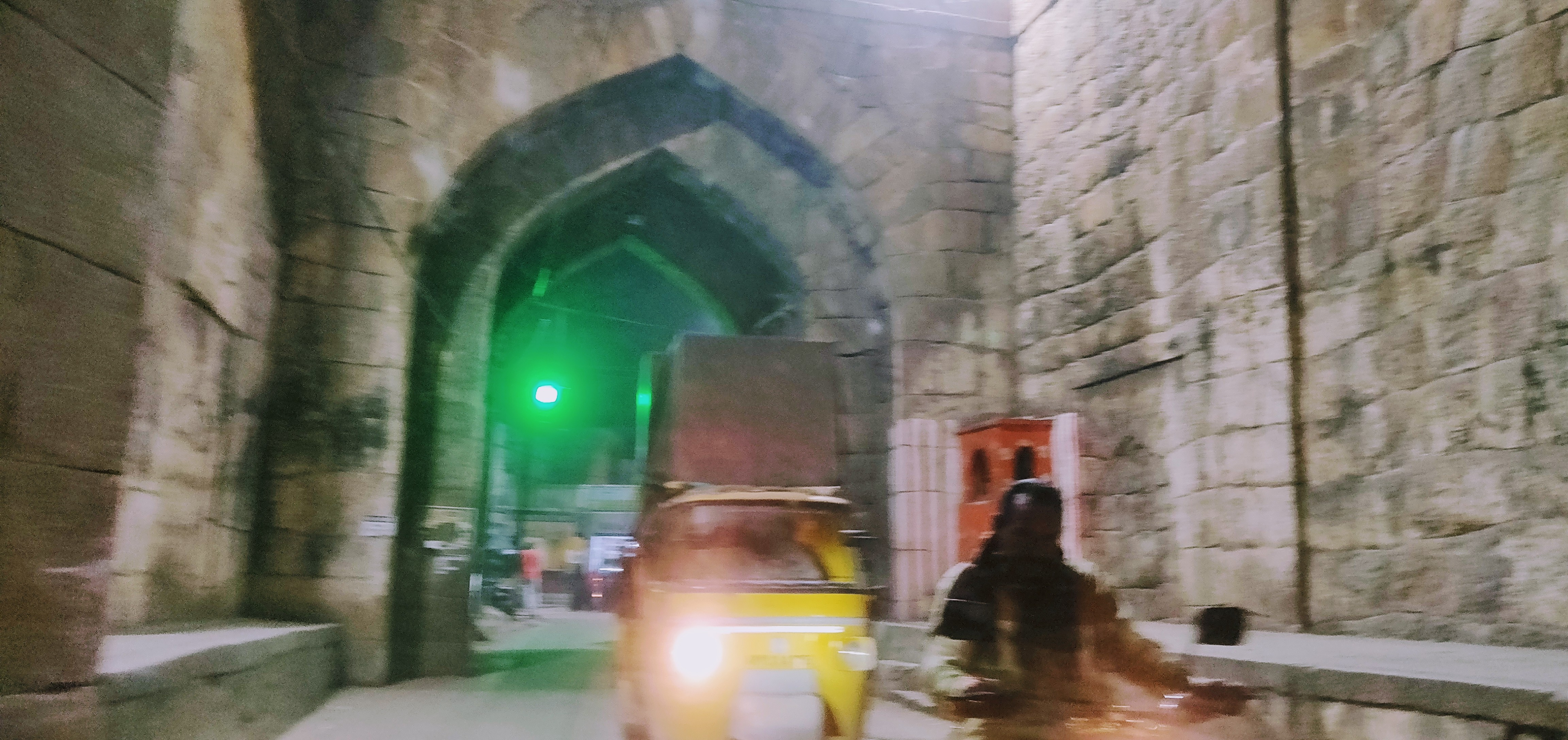 One of the exit points from the Golconda fort, through the old arched doorways, manned by traffic lights