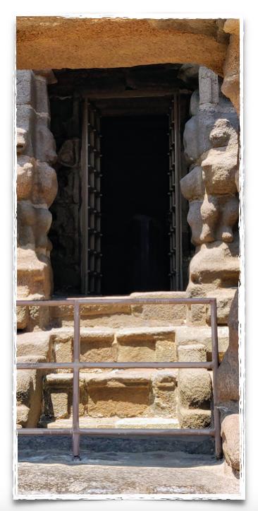 A broken granite Shiva Lingam inside the temple