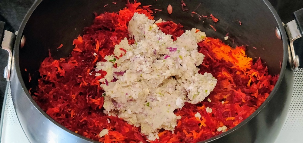 Add the coarsely ground coconut mix to the beet-carrot