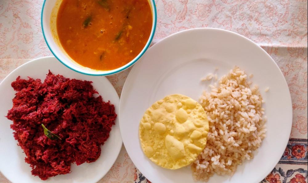 South Indian veg meal - rice with pappadam, sambar, beetroot-carrot thoran.