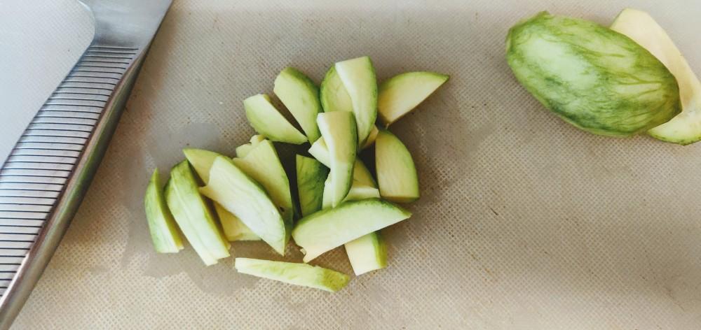 Raw mango, peeled and sliced