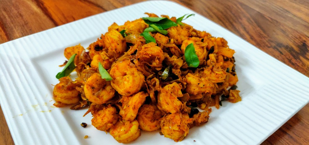 Prawns ularthu -Prawns cooked with coconut pieces; a uniquely Kerala preparation